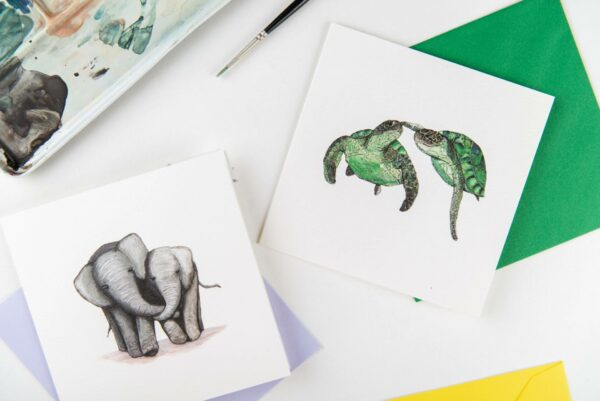 Selection of illustrated animal couple cards, elephants and turtles