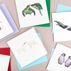 Selection of illustrated animal couple cards, elephants, puffins, penguins, turtles and polar bears