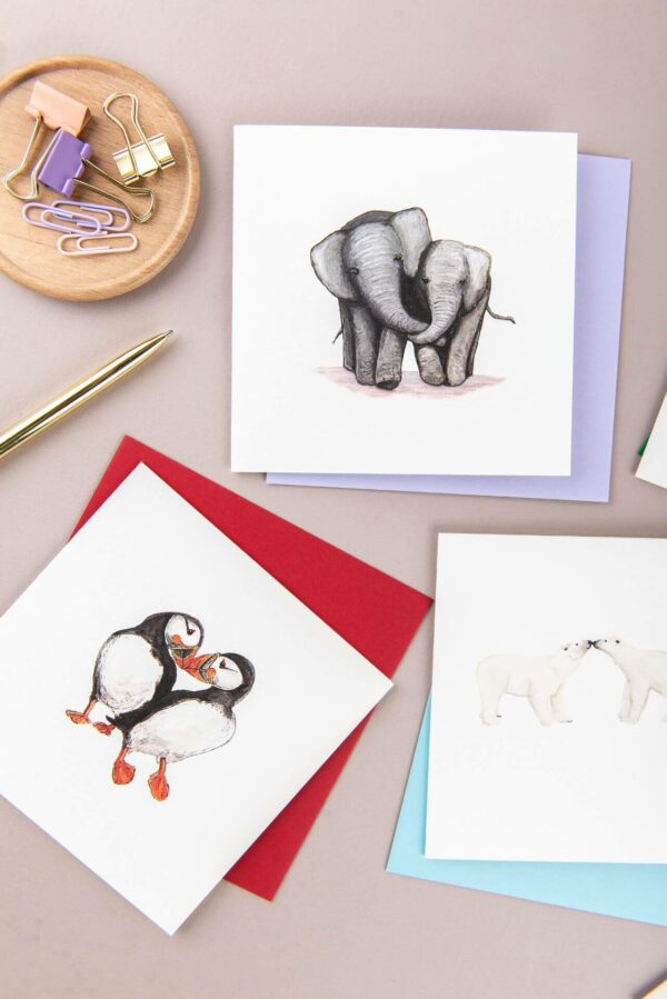 Selection of illustrated animal couple cards, elephants, puffins and polar bears