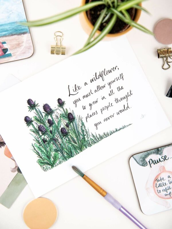 Illustration of wild thistles, with hand lettered quote 'Like a wildflower, you must allow yourself to grow in all the places people thought you never would.'