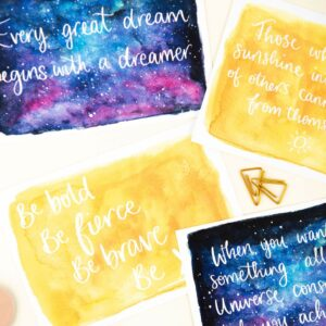 Positive postcards, with hand lettered words over sunshine and night sky watercolour design