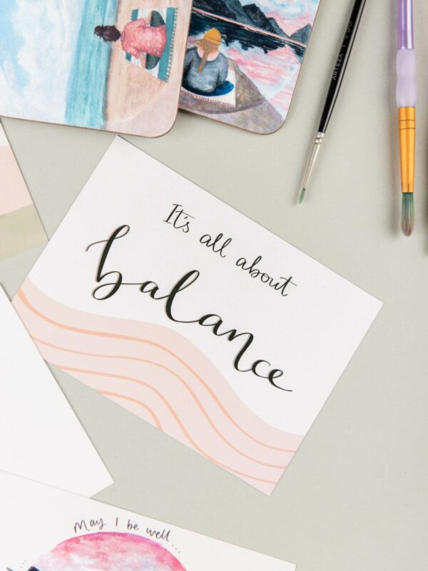 Printed postcard with hand lettering design reads 'It's all about balance'