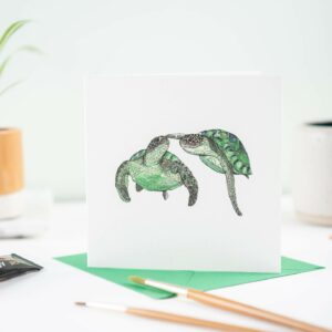 Printed card - two turtles swimming touching flipper to nose