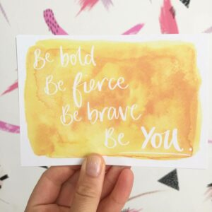 Positive postcard in sunshine yellow with words 'Be bold, be fierce, be brave, be you'