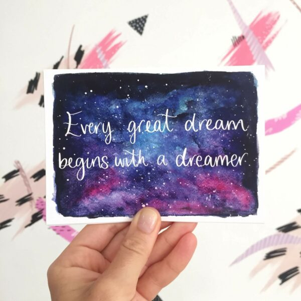 Postcard with quote written on night sky watercolour: 'Every great dream begins with a dreamer'
