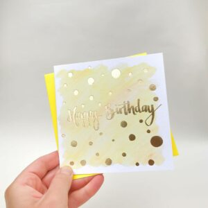 Yellow happy birthday card with luxury gold foil detail