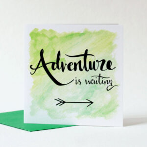 Green card with hand lettered text 'Adventure is waiting' and illustrated arrow