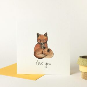 Printed card - illustration of two cute foxes cuddling, with 'love you' text beneath