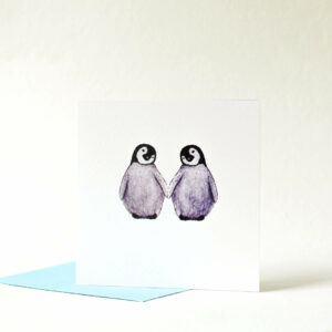 Printed card - two cute fluffy penguins holding flippers