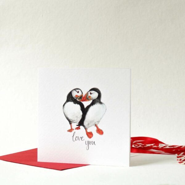 Printed card - two puffins touching beaks and text 'love you' beneath