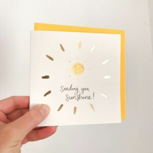 Greeting card - reads 'Sending you sunshine' with sunshine design and gold foil detail