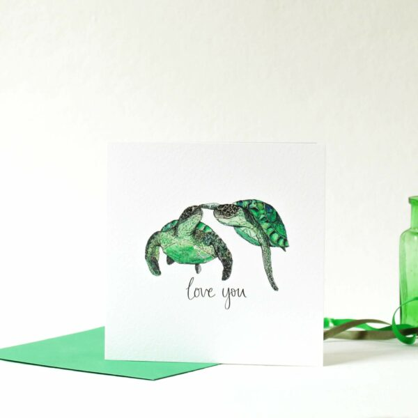 Printed card - two turtles swimming touching flipper to nose and 'love you' text printed beneath