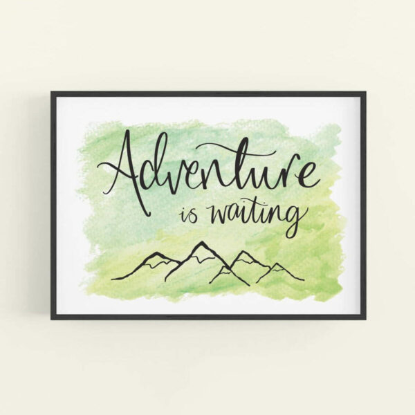 Framed art print with 'Adventure is waiting' text and simple mountain outline design - black frame