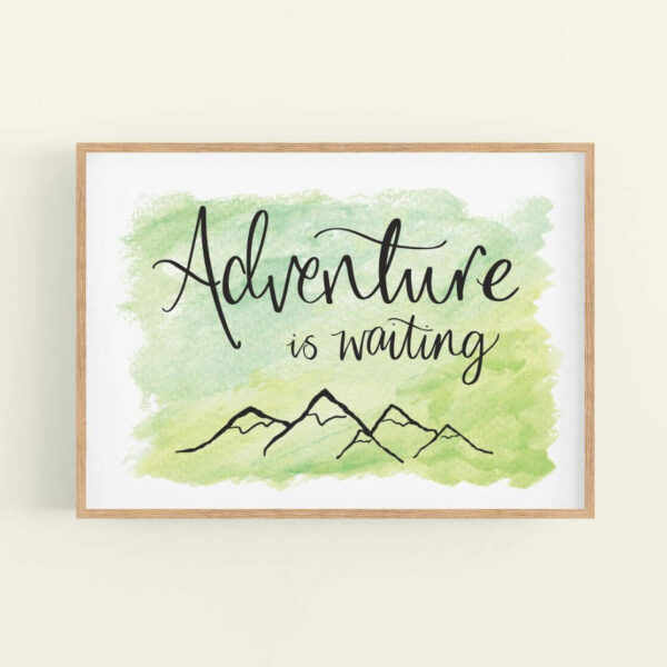 Framed art print with 'Adventure is waiting' text and simple mountain outline design - natural wood frame