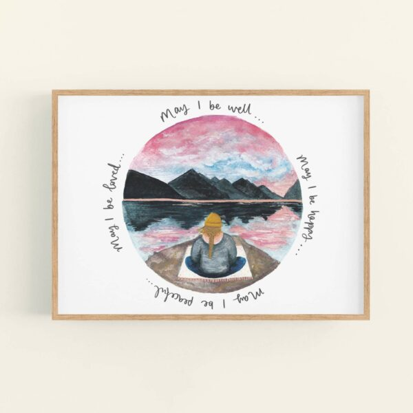 Calming meditating girl sat beneath mountains illustration, words surround the illustration 'May I be well... may I be happy... may I be peaceful... may I be loved' - in a wooden frame