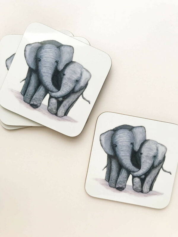 Stack of coasters with illustrated design of 2 cute elephants