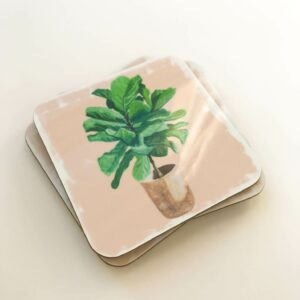 Stack of illustrated house plant coasters in fiddle leaf fig designs
