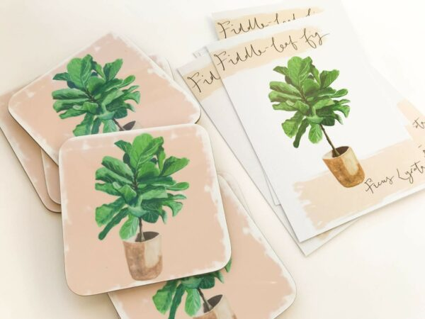 Stack of illustrated house plant coasters in fiddle leaf design and matching postcards