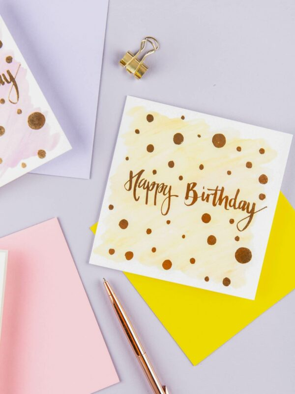 Colourful happy birthday card designs with simple polka dot design and gold foil detail