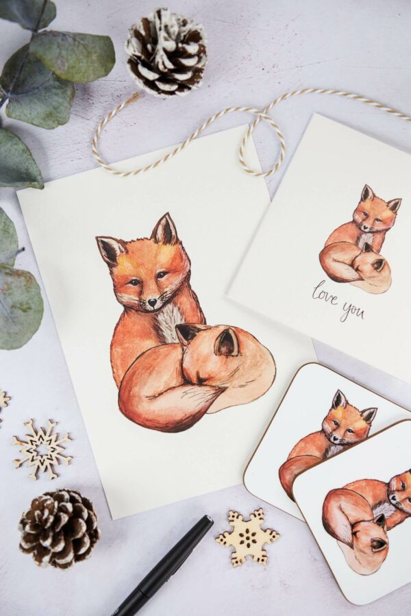 Selection of matching cute fox illustration gifts, including art print, coasters and card that reads 'love you' on the front.