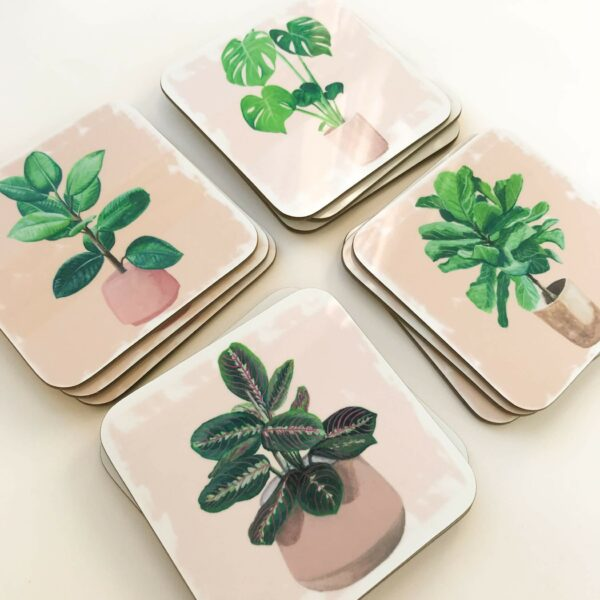 Stack of illustrated house plant coasters in 4 designs