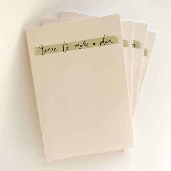 Stack of 'time to make a plan' notebooks in minimal design