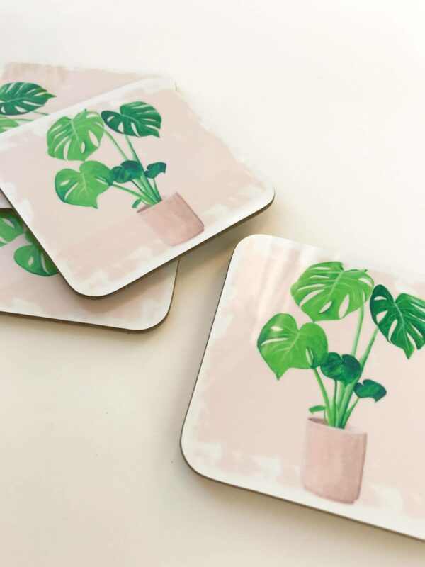 Stack of house plant coasters with monstera illustration design