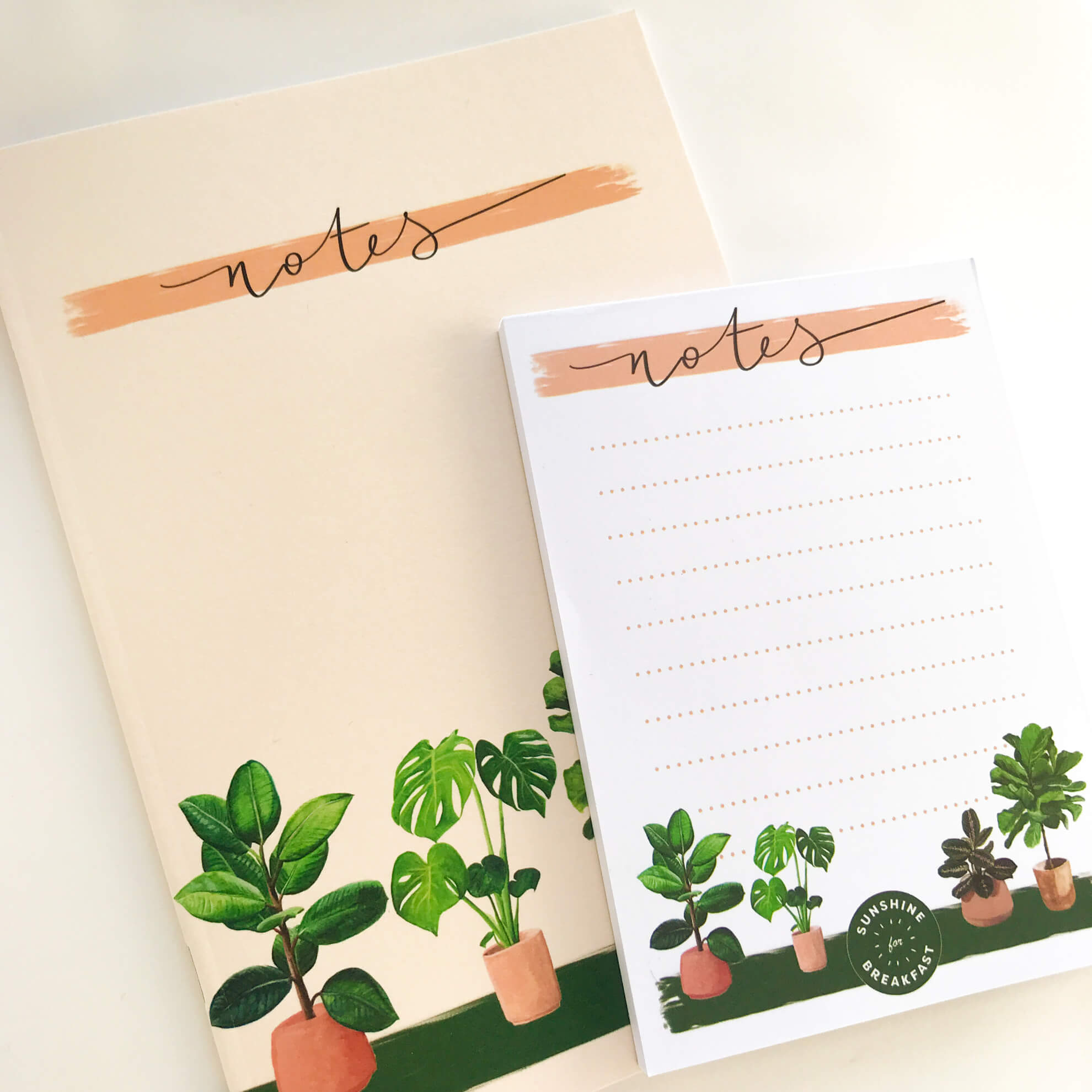 House plants notepad, on top of a house plants notebook, both with 'Note' title at top of page