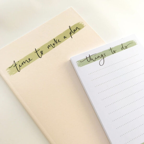 'Things to do' notepad, on top of a 'time to make a plan' notebook