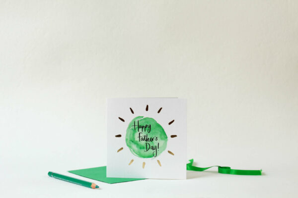 Card reads 'Happy Father's Day!' with green circular design and gold foil detail