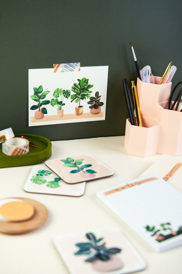 House plant themed stationery and gifts in a green office room