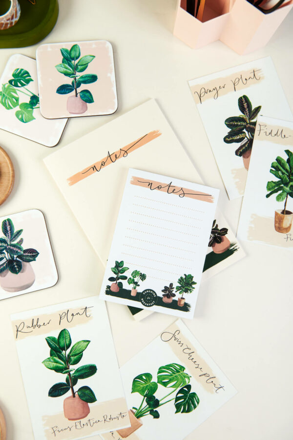 selection of illustrated house plant gifts including notepad, notebook, postcards and coasters